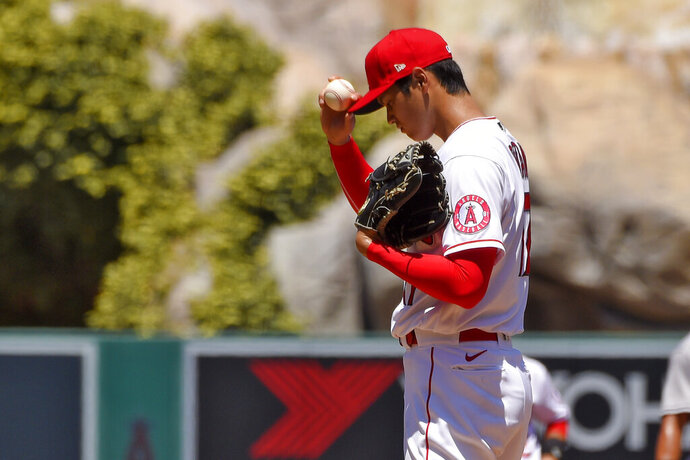Los Angeles Angels pitcher Shohei Ohtani, of Japan, gets set to pitch during the second inning of a baseball game against the Houston Astros Sunday, Aug. 2, 2020, in Anaheim, Calif. (AP Photo/Mark J. Terrill)