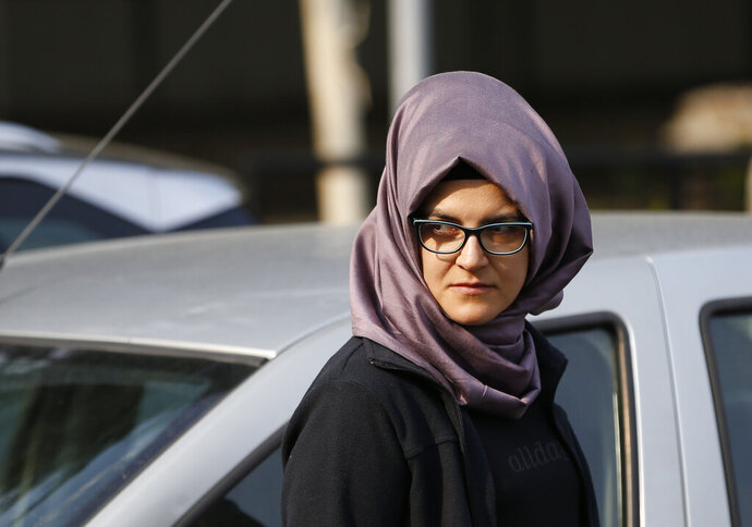 FILE - In this Wednesday, Oct. 3, 2018 file photo, Hatice Cengiz, the Turkish fiancee of Saudi journalist Jamal Khashoggi, stands outside the Saudi Arabia consulate in Istanbul the day after his killing. Turkey's state-run news agency is quoting a police report Thursday, Feb. 14, 2019 suggesting that Cengiz may have escaped being a second victim of the killing. (AP Photo/Lefteris Pitarakis, File)