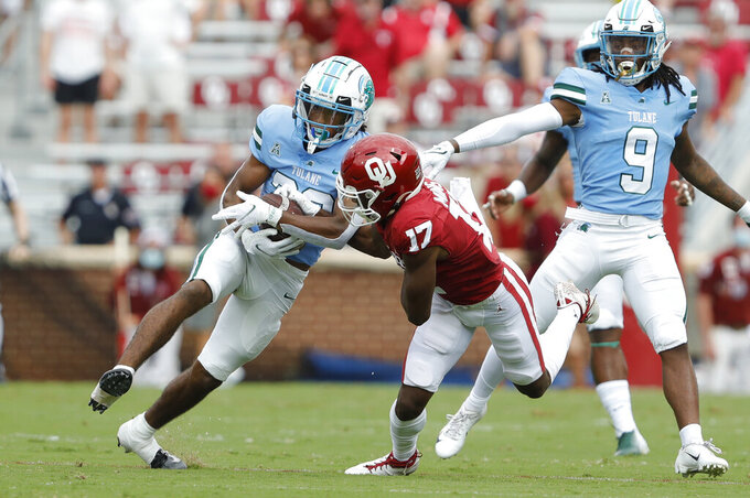 Tulane defensive back Jadon Canady (28) intercepts a pass intended for Oklahoma wide receiver Marvin Mims (17) during a NCAA college football game Saturday, Sept. 4, 2021, in Norman, Okla. (AP Photo/Alonzo Adams)