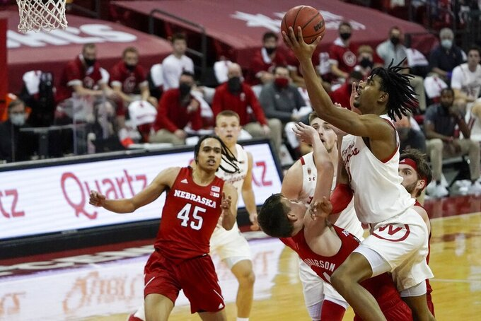 Wisconsin's Aleem Ford shoots over Nebraska's Thorir Thorbjarnarson during the first half of an NCAA college basketball game Tuesday, Dec. 22, 2020, in Madison, Wis. (AP Photo/Morry Gash)