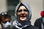 Hatice Cengiz, the fiancee of slain Saudi journalist Jamal Kashoggi, talks to members of the media outside a court in Istanbul, Friday, July 3, 2020, where the trial in absentia of two former aides of Saudi Crown Prince Mohammed bin Salman and 18 other Saudi nationals over the 2018 killing of the Washington Post columnist had began. Turkish prosecutors have indicted the 20 Saudi nationals over Khashoggi's grisly killing at the Saudi Consulate in Istanbul that cast a cloud of suspicion over Prince Mohammed and are seeking life prison terms for defendants who have all left Turkey.  Saudi Arabia rejected Turkish demands for the suspects' extradition and put them on trial in Riyadh.(AP Photo/Emrah Gurel)