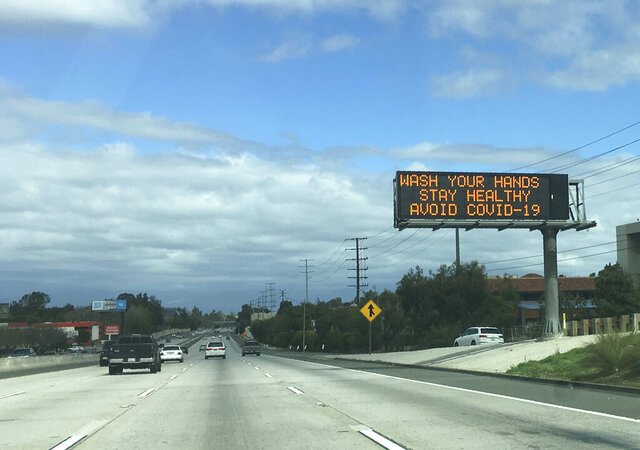 A Caltrans freeway sign reads: