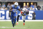 Indianapolis Colts' Marlon Mack (25) runs out of the tackle of Denver Broncos' Justin Simmons (31) during the first half of an NFL football game, Sunday, Oct. 27, 2019, in Indianapolis. (AP Photo/Michael Conroy)