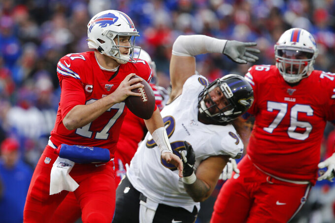 Buffalo Bills quarterback Josh Allen (17) rolls out looking to pass during the second half of an NFL football game against the Baltimore Ravens in Orchard Park, N.Y., Sunday, Dec. 8, 2019. (AP Photo/John Munson)