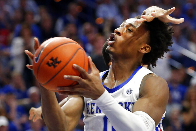 Kentucky's Ashton Hagans (0) shoots while pressured from behind by Alabama's Galin Smith during the first half of an NCAA college basketball game in Lexington, Ky., Saturday, Jan 11, 2020. Kentucky on 76-67. (AP Photo/James Crisp)