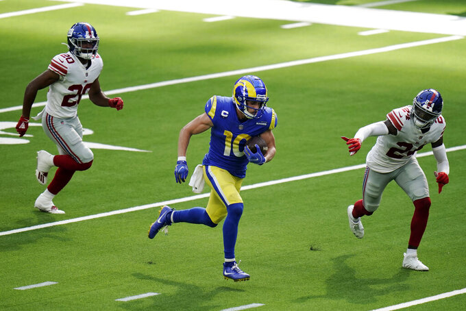 Los Angeles Rams wide receiver Cooper Kupp (10) runs for a touchdown past New York Giants free safety Julian Love, left, and cornerback James Bradberry (24) during the second half of an NFL football game Sunday, Oct. 4, 2020, in Inglewood, Calif. (AP Photo/Jae C. Hong)