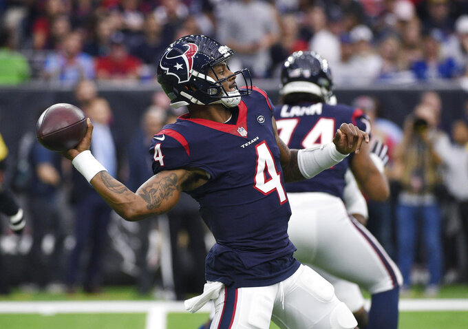 Houston Texans quarterback Deshaun Watson (4) throws against the Indianapolis Colts during the first half of an NFL wild card playoff football game, Saturday, Jan. 5, 2019, in Houston. (AP Photo/Eric Christian Smith)