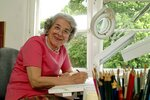 FILE - In this May 23, 2003 file photo British writer Judith Kerr sits in her working room in London, England. Judith Kerr, author and illustrator of the bestselling