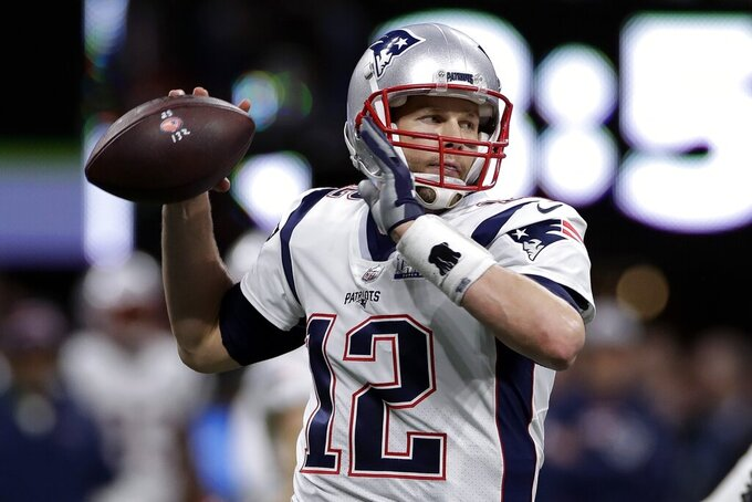FILE - In this Sunday, Feb. 3, 2019 file photo, New England Patriots' Tom Brady passes against the Los Angeles Rams during the first half of the NFL Super Bowl 53 football game in Atlanta. Mention the NFL draft, and the debate begins immediately. Who's the best player ever taken at No. 1 overall or the top player ever taken in a late round? (AP Photo/Carolyn Kaster, File)