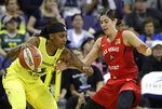 Las Vegas Aces' Kelsey Plum, right, defends against Seattle Storm's Shavonte Zellous during the first half of a WNBA basketball game Friday, July 19, 2019, in Seattle. (AP Photo/Elaine Thompson)