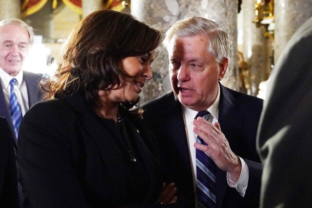FILE - In this Tuesday, Feb. 5, 2019, file photo, Sen. Kamala Harris, D-Calif., and Sen. Lindsey Graham, R-S.C., talk as they arrive to listen to President Donald Trump deliver his State of the Union address to a joint session of Congress on Capitol Hill in Washington. When Harris returned to the Senate the week of Nov. 16, 2020, for the first time as vice president-elect, her Republican colleagues offered their congratulations and Graham greeted her with a fist bump. (AP Photo/Carolyn Kaster, File)
