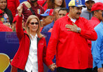 Venezuela's President Nicolas Maduro and first lady Cilia Flores acknowledge supporters at the end of a rally in Caracas, Venezuela, Saturday, Feb. 2, 2019. Maduro called the rally to celebrate the 20th anniversary of the late President Hugo Chavez's rise to power. (AP Photo/Ariana Cubillos)