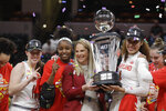 Maryland head coach Brenda Frese,center, celebrates with, from left to right, Taylor Mikesell, Kaila Charles and Shakira Austin after Maryland defeated Ohio State to win the NCAA college basketball championship game at the Big Ten Conference tournament, Sunday, March 8, 2020, in Indianapolis. (AP Photo/Darron Cummings)