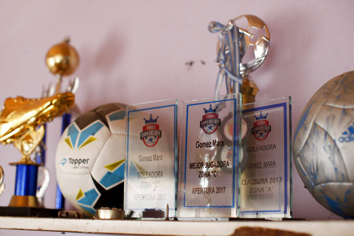 Soccer player Mara Gomez's soccer trophies decorate a shelf at her home in La Plata, Argentina, Thursday, Feb. 6, 2020. Gomez is a transgender woman who is limited to only training with her women's professional soccer team, Villa San Carlos, while she waits for permission to start playing from the Argentina Football Association (AFA). If approved, she would become the first trans woman to compete in a first division, professional Argentine AFA tournament. (AP Photo/Natacha Pisarenko)