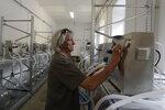 A worker checks a lung ventilator