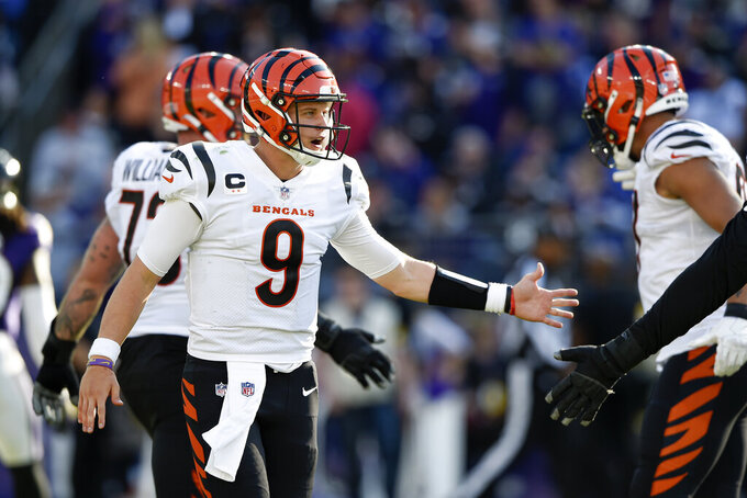 Cincinnati Bengals quarterback Joe Burrow reacts after running back Joe Mixon scored on a touchdown run against the Baltimore Ravens during the second half of an NFL football game, Sunday, Oct. 24, 2021, in Baltimore. (AP Photo/Gail Burton)