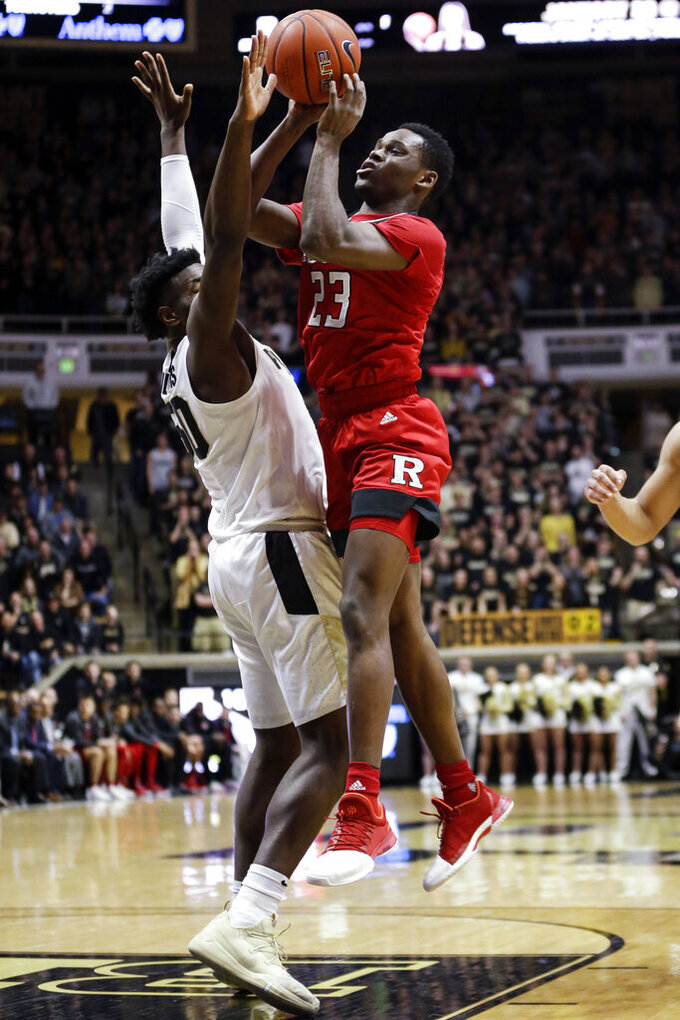 Rutgers guard Montez Mathis (23) shoots over Purdue forward Trevion Williams (50) during the first half of an NCAA college basketball game in West Lafayette, Ind., Tuesday, Jan. 15, 2019. (AP Photo/AJ Mast)
