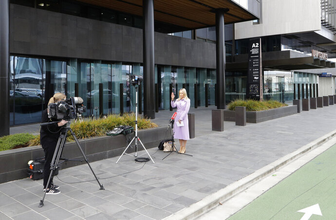 Media film outside the Christchurch High Court in Christchurch, New Zealand, Thursday, March 26, 2020. One year after killing 51 worshipers at two Christchurch mosques, an Australian white supremacist accused of the slaughter on Thursday changed his plea to guilty. Twenty-nine-year-old Brenton Harrison Tarrant pleaded guilty to 51 counts of murder, 40 counts of attempted murder and one count of terrorism. (AP Photo/Mark Baker)