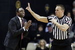 Alabama head coach Avery Johnson argues a call in the first half of an NCAA college basketball game against Vanderbilt, Saturday, Feb. 9, 2019, in Nashville, Tenn. (AP Photo/Mark Humphrey)