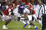 Oklahoma linebacker Kenneth Murray (9) and safety Delarrin Turner-Yell (32) tackle TCU running back Darius Anderson (6) in the first half of an NCAA college football game in Norman, Okla., Saturday, Nov. 23, 2019. (AP Photo/Sue Ogrocki)