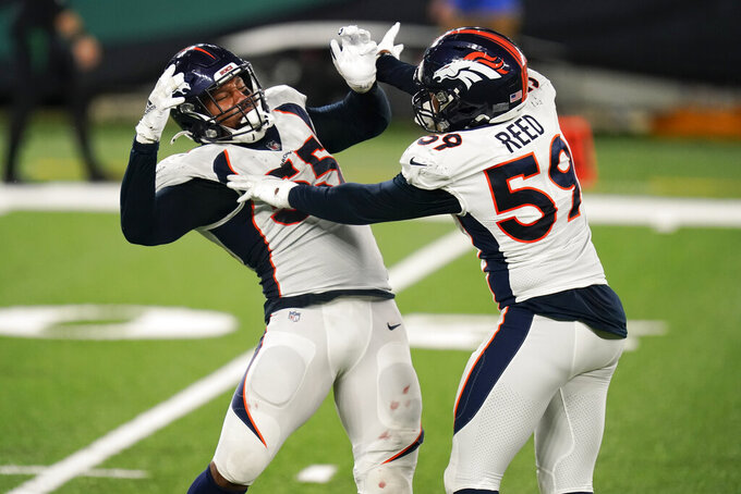 Denver Broncos' Bradley Chubb (55) celebrates a sack with Malik Reed (59) during the second half of the team's NFL football game against the New York Jets on Thursday, Oct. 1, 2020, in East Rutherford, N.J. (AP Photo/Seth Wenig)