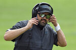 Carolina Panthers head coach Matt Rhule adjusts his headset during the second half of an NFL football game against the Tampa Bay Buccaneers Sunday, Sept. 20, 2020, in Tampa, Fla. (AP Photo/Jason Behnken)