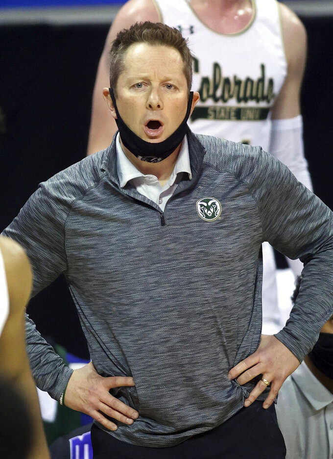 Colorado State coach Niko Medved reacts to a play during the second half of the team's NCAA college basketball game against Fresno State in the quarterfinals of the Mountain West Conference men's tournament Thursday, March 11, 2021, in Las Vegas. (AP Photo/Isaac Brekken)