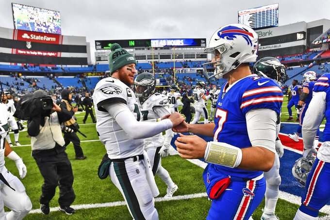 Philadelphia Eagles quarterback Carson Wentz, left, greets Buffalo Bills quarterback Josh Allen after an NFL football game, Sunday, Oct. 27, 2019, in Orchard Park, N.Y. (AP Photo/Adrian Kraus)