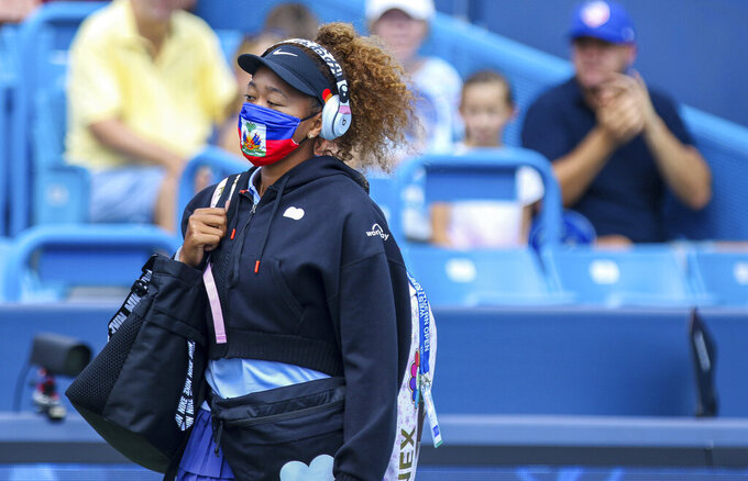 Naomi Osaka enters Center Court during the Western & Southern Open tennis tournament at the Lindner Family Tennis Center, Wednesday, Aug. 18, 2021 in Mason, Ohio.(Cara Owsley/The Cincinnati Enquirer via AP)
