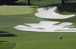 Georgia Tech amateur Tyler Strafaci hits to the 10th green during a practice round for the Masters at Augusta National Golf Club on Sunday, April 4, 2021, in Augusta, Ga. (Curtis Compton/Atlanta Journal-Constitution via AP)