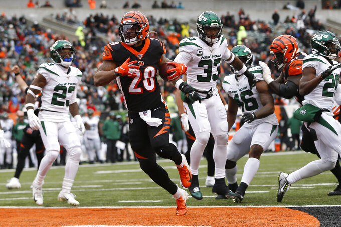Cincinnati Bengals running back Joe Mixon (28) runs in for a touchdown during the first half of an NFL football game against the New York Jets, Sunday, Dec. 1, 2019, in Cincinnati. (AP Photo/Frank Victores)