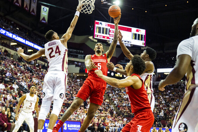 Louisville forward Malik Williams (5) shoots over Florida State guard Devin Vassell (24) in the first half of an NCAA college basketball game in Tallahassee, Fla., Monday, Feb. 24, 2020. (AP Photo/Mark Wallheiser)