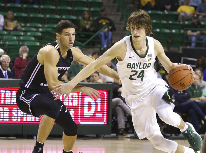 Baylor guard Matthew Mayer (24) drives against Central Arkansas guard Rylan Bergersen (1) in the second half of an NCAA college basketball game Tuesday, Nov. 5, 2019, in Waco, Texas. (AP Photo/ Jerry Larson)