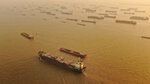 A cargo ship sails along the Yangtze River as seen from an aerial photo in Nantong in eastern China's Jiangsu Province, Jan. 2, 2021. China's exports rose in 2020 despite pressure from the coronavirus pandemic and a tariff war with Washington, boosting its politically volatile trade surplus to $535 billion, one of the highest ever reported. (Chinatopix via AP)