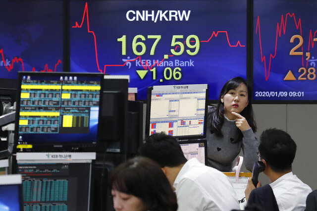 A currency trader gestures at the foreign exchange dealing room of the KEB Hana Bank headquarters in Seoul, South Korea, Thursday, Jan. 9, 2020. Asian stock markets rebounded Thursday as anxiety over potential U.S.-Iranian conflict eased. (AP Photo/Ahn Young-joon)