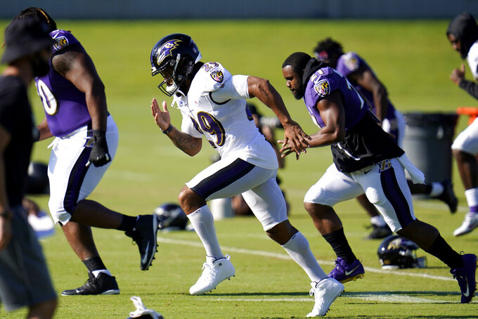 Baltimore Ravens safety Earl Thomas III, center, works out with teammates during an NFL football camp practice, Tuesday, Aug. 18, 2020, in Owings Mills, Md. (AP Photo/Julio Cortez)
