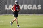 Las Vegas Raiders quarterback Derek Carr (4) runs during an NFL football practice Tuesday, June 15, 2021, in Henderson, Nev. (AP Photo/John Locher)