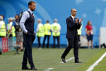FILE - in this photo taken on Saturday, July 14, 2018, Belgium coach Roberto Martinez, background, applauds behind England head coach Gareth Southgate during the third place match between England and Belgium at the 2018 soccer World Cup in the St. Petersburg Stadium in St. Petersburg, Russia. Martinez has signed a new contract to lead the Red Devils through the 2022 World Cup in Qatar. (AP Photo/Natacha Pisarenko)