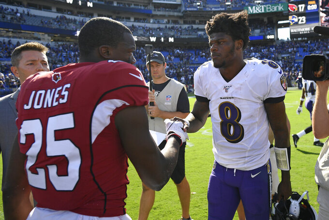 Baltimore Ravens quarterback Lamar Jackson, right, shakes hands with Arizona Cardinals defensive back Chris Jones after an NFL football game, Sunday, Sept. 15, 2019, in Baltimore. Baltimore won 23-17. (AP Photo/Nick Wass)