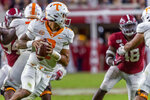 Tennessee quarterback Jarrett Guarantano (2) rolls out during the second half of the team's NCAA college football game against Alabama on Saturday, Oct. 19, 2019, in Tuscaloosa, Ala. (AP Photo/Vasha Hunt)