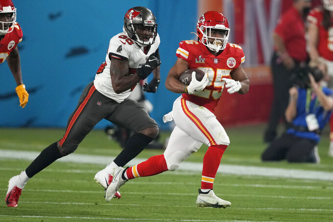 Kansas City Chiefs running back Clyde Edwards-Helaire, right, runs form Tampa Bay Buccaneers cornerback Jamel Dean during the second half of the NFL Super Bowl 55 football game, Sunday, Feb. 7, 2021, in Tampa, Fla. (AP Photo/Chris O'Meara)