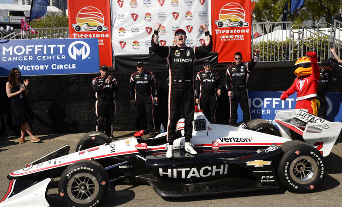 FILE - In this Sunday, March 10, 2019, file photo, Team Penske driver Josef Newgarden (2) celebrates after winning the IndyCar Grand Prix auto race in St. Petersburg, Fla. IndyCar plans to crown its champion on the streets of St. Petersburg, Florida, as the original opener has been rescheduled to Oct. 25 as the finale. (AP Photo/Jason Behnken, File)