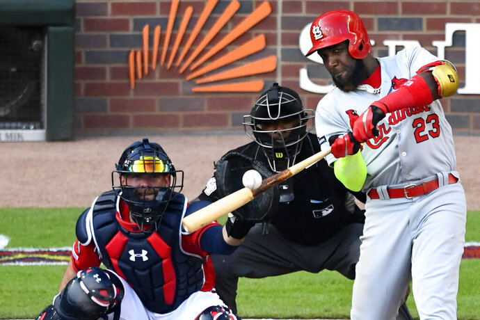 FILE - In this Friday, Oct. 4, 2019 file photo, St. Louis Cardinals left fielder Marcell Ozuna (23) hits a single against the Atlanta Braves in the fourth inning during Game 2 of a best-of-five National League Division Series in Atlanta. Free agent outfielder Marcell Ozuna and the Atlanta Braves reached an $18 million, one-year deal Tuesday, Jan. 21, 2020 that puts him on the team he helped beat in the playoffs last October. (AP Photo/Scott Cunningham, File)