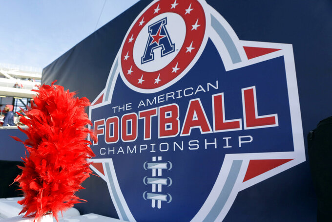 FILE - In this Dec. 5, 2015, file photo, the American Athletic Conference logo is displayed before during the championship NCAA college football game between Houston and Temple in Houston. Six schools from Conference USA — UAB, UTSA, Rice, North Texas, Charlotte and Florida Atlantic — have applied for membership with the AAC and are expected to be accepted by the end of the week, according to two people with knowledge of the process who spoke with The Associated Press, Wednesday, Oct. 20, 2021. (AP Photo/David J. Phillip, File)