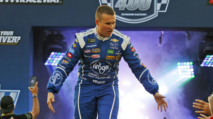 Ryan Preece greets fans during driver introductions for the NASCAR Monster Energy Cup series auto race at Richmond Raceway in Richmond, Va., Saturday, Sept. 21, 2019. (AP Photo/Steve Helber)