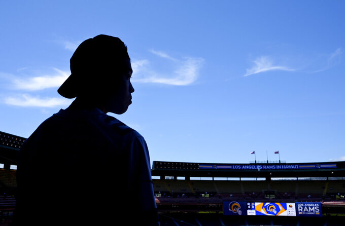 Masaki Nobuhara waits prior to a pre-season NFL football game between the Los Angeles Rams and the Dallas Cowboys on Saturday, Aug. 17, 2019, in Honolulu. (AP Photo/Mark J. Terrill)