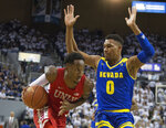 UNLV guard Kris Clyburn (1) drives on Nevada forward Tre'Shawn Thurman (0) during the first half of an NCAA college basketball game in Reno, Nev., Wednesday, Feb. 27, 2019. (AP Photo/Tom R. Smedes)