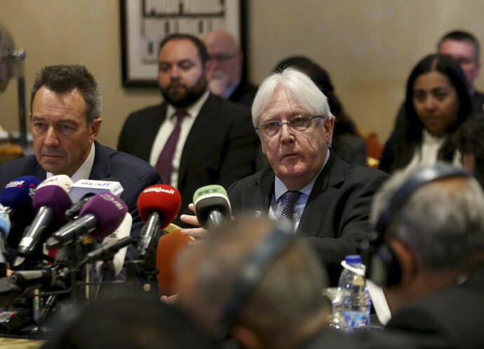 FILE - In this Feb. 5, 2019 file photo, United Nations Special Envoy to Yemen Martin Griffiths, center, and President of the International Committee of the Red Cross Peter Maurer, speak during a new round of talks by Yemen's warring parties in Amman, Jordan.  Yemen's warring sides on Friday, Sept. 18, 2020,  started U.N.-brokered peace consultations in Switzerland to exchange prisoners, the United Nations said, part of a long-delayed deal aiming to end a conflict that has killed thousands of civilians and set off the world's worst humanitarian crisis. (AP Photo/Raad Adayleh)