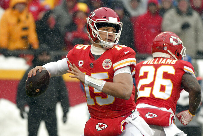 Kansas City Chiefs quarterback Patrick Mahomes (15) throws during the first half of an NFL divisional football playoff game against the Indianapolis Colts in Kansas City, Mo., Saturday, Jan. 12, 2019. (AP Photo/Ed Zurga)