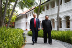 FILE - In this June 12, 2018, file photo, President Donald Trump walks with North Korean leader Kim Jong Un on Sentosa Island in Singapore. In recent weeks it's become clear that Donald Trump wants to meet with Kim Jong Un again, and the North Korean leader has told the White House he'd like more face-to-face talks with the American president. (AP Photo/Evan Vucci, File)